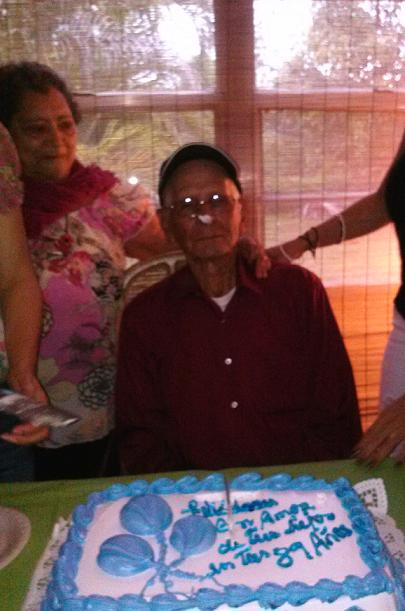 Yes that's cake on his nose LOL and that's my grandma next to him <3